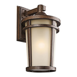 Kichler 1-Light Outdoor Fixture - Brown Stone Exterior - One Light Outdoor Fixture. The simple transitional style of this 1 light fluorescent wall lantern from the Atwood family is perfect for today`s traditional architecture. The subtle tone of the brownstone finish and light umber seedy glass coordinate beautifully. Everything about this tapered round lantern from its cast aluminum rings to its stepped canopy make it an ideal complement to your home. Width: 10 inches, height: 18 inches. Uses 1 18 w bulb. Rated for wet locations. Meets energy star, dark sky, and title 24 requirements. Bulb included.