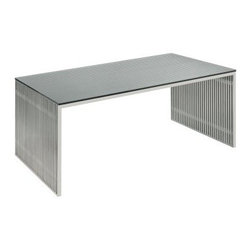 Nuevo Amici Laptop/Writing Desk - The Nuevo Amici Laptop/Writing Desk is a metallic marvel for the modern era. This piece's base is constructed from stainless steel brushed for a soft shine and features a unique slatted design conjuring up a world of texture for your workspace. Held aloft is a clear glass desktop tempered for durability so you your computer and all of your desk items will be safe and sound. This desk arrives fully assembled and measures 48W x 28D x 30H inches.About NuevoOne of the most exciting contemporary design companies in the market Nuevo has made a name for itself with its unique approach to professional-quality home furnishings. Creating pieces with a thoroughgoing contemporary edge Nuevo never fails to make a fashionable statement of the highest construction value.