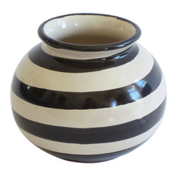 Round Striped Vase - Add the finishing touch to your shelf or mantle with this cute little striped vase. It's great for holding flowers from your garden, or simply juxtaposed with your room's fun, bright colors. Talavera Vazquez's bubbly, round design and bold stripes will make this little guy a favorite for years to come.