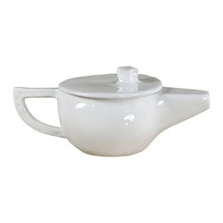 Montes Doggett - Handmade Teapot - This beautifully handmade ceramic teapot would make a great gift for the tea lover in your life. The original Peruvian design can easily be used in the microwave and then cleaned in the dishwasher, making tea time even more appealing.
