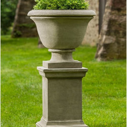 Campania International - Campania International Greenwich Urn Planter with Pedestal - PPD-325-AL - Shop for Planters and Pottery from Hayneedle.com! Add visual intrigue to your landscape design by elevating flowers in this Campania International Greenwich Urn Planter with Pedestal. This set includes a heavily ornamented urn planter with elegant scrollwork and a fluted base. It stands on a stately pedestal base. Both are crafted of cast stone using a 15-step process that will withstand the elements beautifully. Choose from a variety of weathered finish options. Campania Cast Stone: The ProcessThe creation of Campania's cast stone pieces begins and ends by hand. From the creation of an original design making of a mold pouring the cast stone application of the patina to the final packing of an order the process is both technical and artistic. As many as 30 pairs of hands are involved in the creation of each Campania piece in a labor intensive 15 step process.The process begins either with the creation of an original copyrighted design by Campania's artisans or an antique original. Antique originals will often require some restoration work which is also done in-house by expert craftsmen. Campania's mold making department will then begin a multi-step process to create a production mold which will properly replicate the detail and texture of the original piece. Depending on its size and complexity a mold can take as long as three months to complete. Campania creates in excess of 700 molds per year.After a mold is completed it is moved to the production area where a team individually hand pours the liquid cast stone mixture into the mold and employs special techniques to remove air bubbles. Campania carefully monitors the PSI of every piece. PSI (pounds per square inch) measures the strength of every piece to ensure durability. The PSI of Campania pieces is currently engineered at approximately 7500 for optimum strength. Each piece is air-dried and then de-molded by hand. After an internal quality check pieces are sent to a finishing department where seams are ground and any air holes caused by the pouring process are filled and smoothed. Pieces are then placed on a pallet for stocking in the warehouse.All Campania pieces are produced and stocked in natural cast stone. When a customer's order is placed pieces are pulled and unless a piece is requested in natural cast stone it is finished in a unique patinas. All patinas are applied by hand in a multi-step process; some patinas require three separate color applications. A finisher's skill in applying the patina and wiping away any excess to highlight detail requires not only technical skill but also true artistic sensibility. Every Campania piece becomes a unique and original work of garden art as a result.After the patina is dry the piece is then quality inspected. All pieces of a customer's order are batched and checked for completeness. A two-person packing team will then pack the order by hand into gaylord boxes on pallets. The packing material used is excelsior a natural wood product that has no chemical additives and may be recycled as display material repacking customer orders mulch or even bedding for animals. This exhaustive process ensures that Campania will remain a popular and beloved choice when it comes to garden decor.About Campania InternationalEstablished in 1984 Campania International's reputation has been built on quality original products and service. Originally selling terra cotta planters Campania soon began to research and develop the design and manufacture of cast stone garden planters and ornaments. Campania is also an importer and wholesaler of garden products including polyethylene terra cotta glazed pottery cast iron and fiberglass planters as well as classic garden structures fountains and cast resin statuary.
