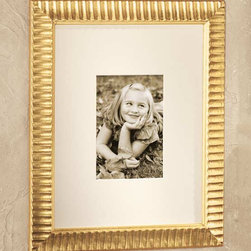 """Exposures - Bellagi Fluted Gold Frame - Overview These distinguished Italian wall frames use meticulous detail to create an extraordinary accent for the contemporary or traditional home. Gold finish Bellagi photo frame has an ivory mat. p> Features Solid wood moldings Vertical or Horizontal Wall display only Available in various sizes Made in Italy  Specifications   Bellagi Gold Frame with 3 1/5"""" x 5"""" photo opening measures  9 1/2"""" wide x 8 1/2"""" high Bellagi Gold Frame with 4"""" x 6"""" photo opening measures  12 1/2"""" wide x 10 1/2"""" high Bellagi Gold Frame with 5"""" x 7"""" photo opening measures  16 1/2"""" wide x 13 1/2"""" high"""