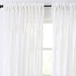 """Smocked Cotton Voile Pole Pocket Drape, 42 x 63"""", White - The Smocked Drape's sheer cotton voile is smocked by hand in a diamond pattern on top and falls in graceful pleats. Adorned with a hand-smocked diamond pattern over the top 8"""". Sheer 100% cotton voile is airy and provides high light filtration. Hangs from the pole pocket or converts to ring-top style with clip rings. Use with 10 Clip Rings (sold separately). White and Khaki are shown. Watch a video on {{link path='/stylehouse/videos/videos/h2_v1_rel.html?cm_sp=Video_PIP-_-PBQUALITY-_-HANG_DRAPE' class='popup' width='420' height='300'}}how to hang a drape{{/link}}. Catalog / Internet Only. Imported."""