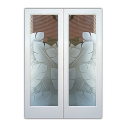 "Glass Front Entry Doors - Frosted Glass Obscure - BANANA LEAVES 3D - Glass Front Doors, Entry Doors that Make a Statement! Your front door is your home's initial focal point and glass doors by Sans Soucie with frosted, etched glass designs create a unique, custom effect while providing privacy AND light thru exquisite, quality designs!  Available any size, all glass front doors are custom made to order and ship worldwide at reasonable prices.  Exterior entry door glass will be tempered, dual pane (an equally efficient single 1/2"" thick pane is used in our fiberglass doors).  Selling both the glass inserts for front doors as well as entry doors with glass, Sans Soucie art glass doors are available in 8 woods and Plastpro fiberglass in both smooth surface or a grain texture, as a slab door or prehung in the jamb - any size.   From simple frosted glass effects to our more extravagant 3D sculpture carved, painted and stained glass .. and everything in between, Sans Soucie designs are sandblasted different ways creating not only different effects, but different price levels.   The ""same design, done different"" - with no limit to design, there's something for every decor, any style.  The privacy you need is created without sacrificing sunlight!  Price will vary by design complexity and type of effect:  Specialty Glass and Frosted Glass.  Inside our fun, easy to use online Glass and Entry Door Designer, you'll get instant pricing on everything as YOU customize your door and glass!  When you're all finished designing, you can place your order online!   We're here to answer any questions you have so please call (877) 331-339 to speak to a knowledgeable representative!   Doors ship worldwide at reasonable prices from Palm Desert, California with delivery time ranges between 3-8 weeks depending on door material and glass effect selected.  (Doug Fir or Fiberglass in Frosted Effects allow 3 weeks, Specialty Woods and Glass  [2D, 3D, Leaded] will require approx. 8 weeks)."