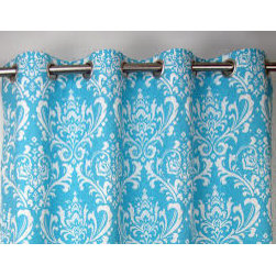 Blue Grommet Curtains & Draperies of Indianapolis- Custom Styles at Affordable P - This is a picture of grommet draperies.  We like this style for a modern or transitional look.  The blue and white printed fabric adds detail to your space.  The trick to remember when using grommet curtains or draperies is to use a non-telescoping rod.  The reason is, the grommets will get caught on the rod where the two sections meet.  This is quite annoying and can be avoided by simply using a custom cut rod. The thought of custom cut rods can make some people feel overwhelmed.  But no worries, we have a special line of custom cut rods that are easily installed, great quality and a great value.  They are cut with a simple and inexpensive pipe cutter.  We can install them for you or ship it directly to you!