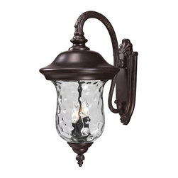 Three Light Bronze Clear Waterglass Glass Wall Lantern - Traditional charm emanates from this large outdoor wall mount fixture, which pairs clear water glass with rubbed bronze hardware for a timeless look.