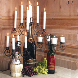 Tuscan Wine Bottle Candelabras - These clever wine bottle candelabras easily fit on the top of a standard wine bottle. Each held securely in place by a stopper, adds a stunning but unbelievably simple touch of elegance and romance to your table. Available in two styles; Wine bottle votive or taper candelabra. The Champagne bottle taper candelabra is discontinued.