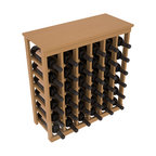 36 Bottle Kitchen Wine Rack in Pine with Oak Stain + Satin Finish - A small wine rack with big storage. This wine rack kit is the best choice for converting tiny spaces into big wine storage. The solid wood top excels as a table for wine accessories, small plants, and wine collectables. Store 3 cases of wine properly in a space smaller than most entry tables!