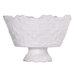 "Home Essentials - Fancy Scroll Style White Serving Bowl - Youll be serving up style with this ceramic white serving bowl. It has a scalloped rim and pedestal base, bringing a feel of five-star dining to your guests. With its intricate detailing and elegant presence, the sweet olive bowl in its creamy white color is the perfect addition to your serveware and great for salads, pasta and fruits.           * Dimensions: 6.5""H x 9.25""D     * Microwave and Dishwasher Safe"