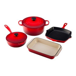 "Le Creuset - Le Creuset Cast Iron 6 Piece Signature Cookware Set - Colorful, long-lasting exterior enamel resists chipping and cracking. Sand-colored interior enamel makes it easy to monitor cooking progress. Large handles provide a sure grip, even with oven mitts. The lightest weight per quart of any premium cast iron cookware available. Secure lid wont slide or rock. Phenolic knobs withstand temperatures up to 500""FItem Includes:    5.5"" quart round French oven    2.25"" quart saucier    Square Skillet Grill    2.5"" qt. roaster. Compatible with Gas, Electric, Ceramic, Halogen, Induction, Oven & Outdoor GrillDishwasher safe. Lifetime warranty.. Made in France."