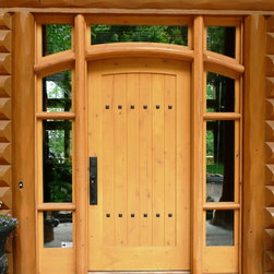 Entry Doors - Custom Alder Entry System with sidelights and transom. Solid wood panel with v-grooves and iron clavos.