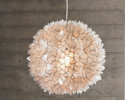 VivaTerra - Lotus Flower Chandelier - This round pouf has much more too it than meets the eye. It's a a globe light covered in metal-edged, hand-cut capiz shells that come together to cover it in lotus flowers. The result is a warm glow through the glass.