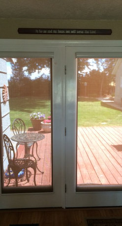 French Door Cordless Solar Shades by Insolroll - American made insolroll solar shades are the perfect choice for anyone who wants to block the sun and heat but not block the view! These shades have the quiet spring upgrade that makes them cordless and very user friendly. These shades are a 5% openness which means they block 95% of harmful UV rays which normally bleach furniture and hardwood floors.