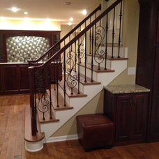 Traditional Basement by Young Remodeling
