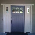 Doors - The Arts and Crafts movement is alive and strong in Northern California and this door is an excellent example of that architectural style.  Over-sized width, square sticking, high mid rail and tall panels.  All very definitive of the Craftsman style.  Also note the extended tails on the head of the door casing.  We provided architectural design and detailing, mill work products and installation services on this magnificent remodel.