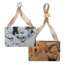 "Exposures - Personalized Photo Ornament - Overview Simply upload your favorite photo, and well reproduce it on our best-selling personalized photo ornament using a new translucent process with an iridescent sheen. Add your personal message to the back. Wire-edged hanging ribbon with shimmering star included with each photo ornament. Choose B&W, color or sepia. 3"" x 5"" personalized ornament. Personalize with up to 2 lines, 20 characters per line. Personalization Personalize with up to 2 lines, 20 characters per line Specifications Measures 3"" x 5"""