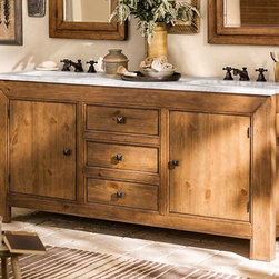 Stella Double Sink Console - The natural whorls and fissures of pine give our Stella Double Sink Console its warm, mountain cabin appeal. Its thick, substantial silhouette is softened by the milky hues and crystalline veins of Carrara marble.