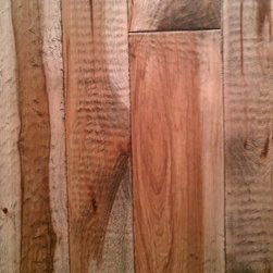 """Old Americana - Hand scraped Hickory plank floor, 5"""" Wide Planks - This floor is hand made right here in the U.S.A. by our artisans! Each plank is hand selected and graded to a #1 & #2 mix, making for a longer, natural character grade product. Then it's precision milled to exact specifications. Then each board is meticulously hand scraped, one plank at a time, until every inch is covered. It then makes its way to our UV finish line where our finish specialists apply the color of your choosing, and 2 coats of WOCA UV oil finish, which is brushed in and hand rubbed before going through the curing ovens. The result is a fabulous, hand made hardwood floor that will patina over the years and get better looking over time, unlike the cheap polyurethane finishes that will """"ugly out"""" over time and eventually need to be refinished."""
