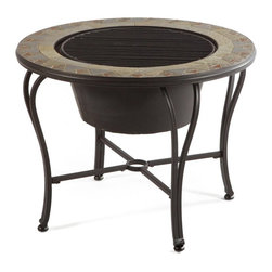 Alfresco Home - Notre Dame Mosaic Fire Pit / Beverage Cooler Table - 21-1337 - Shop for Fire Pits and Fireplaces from Hayneedle.com! Spend your evenings gathered around the beautiful Notre Dame Mosaic Fire Pit / Beverage Cooler Table. Or if it's a hot day grab some ice and toss it into the beverage cooler with a few drinks and spend some time outdoors before it gets too cold. Expertly crafted from hand forged wrought iron the frame of this fire pit is dipped in a zinc-phosphate bath and E-coated to create a weather-resistant coating. It's finished with a powder coating to provide an extra layer of rust-resistant protection but also creates a stronger richer frame color that lasts for years. With each tile expertly laid by hand to create a unique mosaic table top this fire pit is a beautiful and well-crafted piece. Made from natural sources such as marble slate and travertine each tile varies slightly in color resulting in each fire pit being truly unique. The top is then grouted with industrial adhesives for durability so the natural beauty of this table is maintained. An iron fire bowl spark plate and wood grate are included so you can make warm fires to sit around in the evening while a beverage cooler bowl allows you to turn this fire pit into the perfect coffee table for entertaining during warm days. Or simply place the centerpiece on top and have a simple yet elegant coffee table at your disposal. You and your family will love having the opportunity to roast hot dogs over the fire followed by s'mores without having to drive miles into the wild to do so. And your friends will love coming over whether it's to warm their hands by the fire or to enjoy some cold drinks on a hot day. Beautiful and versatile you and your family will love this table. Additional Features Doubles as a fire pit and beverage table Place cover on top to create a regular table Frame is weather and rust resistant Made with rust proof stainless steel hardware Iron has a thickness of 5mm to 6m