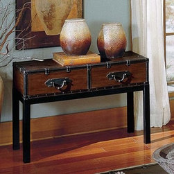 Steve Silver Voyage Trunk Console Table - Add a touch of Old World charm and the spirit of adventure to your foyer study or living room with the Voyage Trunk Console Table. This trunk-style table is crafted from hardwood solids and finished in a dark brown. Faux-leather trim and straps metal pulls and nail head trim add a touch of authenticity and character while square legs and clean lines give it a sturdy stance and a stately look.