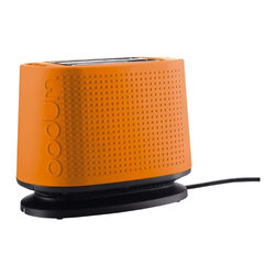 BISTRO Toaster Orange - I would love this toaster. Most of us have some boring stainless steel or white toaster sitting on the counter just looking dreadful — not only would I love to get rid of my ugly white toaster, but I'd love to get this one to bring some color to my kitchen. What I love most about it is that it doesn't even look like a toaster anymore!