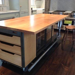 White Oak and Blackened Steel Kitchen Island - Custom kitchen island for a renovated 1840s farmhouse in Millbrook, NY. In quarter sawn white oak and blackened steel, with sliding glass doors. Collaboration with  James Dixon Architect and Get Bent Metalworks.
