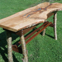 Turquoise Inlay Live Edge Console Table - This rustically elegant console table starts with a piece of live edge yellow birch, and is accented with a cherry apron, Brazilian walnut stretchers, and yellow birch legs. The top and the peg holes are inlaid with turquoise to add some rustic bling.