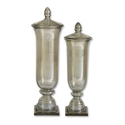 Uttermost - Uttermost Gilli Glass Decorative Containers, Set of 2 19148 - Not only are these containers pretty, made from transparent pale green glass; they are also multifunctional. Use them to display colorful beads or remove the lids and use as a vase for those special cut flowers or simply display them as they are.