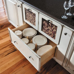 Getting Organized with Fieldstone Cabinetry - Dish storage drawer.  Smaller drawers above have a compartment for display or storage, used here for corks, but you could many other things