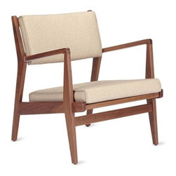 Design Within Reach - Jens Chair   Design Within Reach - Jens Risom has been a part of the DWR family from the beginning, which is why it's appropriate that he should be involved with one of the first projects by DWR Design Studio. In 2007, we started collaborating with Risom to reintroduce the chair and ottoman he originally designed in 1949 for the Caribe Hilton Hotel in Puerto Rico. Decades have passed since this collection was in production, and Risom worked closely with us in every step of its return, from reviewing prototypes, to adjusting tiny details, to advocating cost effective changes in the manufacturing process. The Jens Chair and Ottoman (2008) look the same as the ones made in 1949, but thanks to Risom's input, they are smarter solutions that take advantage of resources and tools that weren't available 60 years ago. Like all of the furniture by this iconic designer, this collection has a subtle Scandinavian sensibility that works with modern and traditional settings.