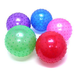 """9 Inch Inflatable Knobby Ball - When my family and I checked into a local resort for a weekend """"staycation"""" this summer, the front desk person handed the kids these knobby balls. They had a blast playing with them in the pool."""