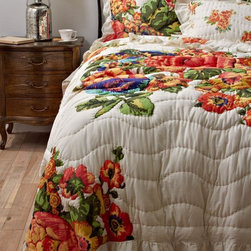 Esperanza Quilt - The big, bold floral pattern on this quilt feels like a breath of fresh air. Bring it out on extra-cold nights when a reminder of spring's blooms will be most appreciated.