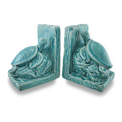 Zeckos - Set of 2 Ceramic Sea Turtle Crackle Finish Bookends - This set of 2 sea turtle bookends will add a bit of colorful marine decor to your home, office or shop, and feature a sea turtle resting on a sea rock. With a crackled glazed finish, the tranquil turquoise color is sure to both relax you, and invigorate your space Crafted from ceramic, each piece measures 6.5 inch (17 cm) high, 5.25 inches (13 cm) long and 4.5 inches (11 cm) wide with foam pads on the bottom to help prevent scratching display surfaces. This set of 2 seahorse bookends makes a wonderful gift for a friend that loves to read and for fans of nautical decor