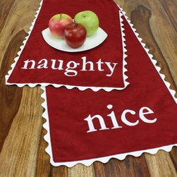Chooty and Co Cinnabar Naughty-Nice Table Runner - Let them know you're always watching with the Chooty and Co Cinnabar Naughty-Nice Table Runner on the holiday table. This fun table runner is made of 100% polyester suede in festive cinnabar red. It's trimmed in winter white ric rac trim and embroidered with naughty on one side and nice on the opposite. Hand- or spot-clean to keep it looking beautiful.About Chooty & Co.A lifelong dream of running a textile manufacturing business came to life in 2009 for Connie Garrett of Chooty & Co. This achievement was kicked off in September of '09 with the purchase of Blanket Barons, well known for their imported soft as mink baby blankets and equally alluring adult coverlets. Chooty's busy manufacturing facility, located in Council Bluffs, Iowa, utilizes a talented team to offer the blankets in many new fashion-forward patterns and solids. They've also added hundreds of Made in the USA textile products, including accent pillows, table linens, shower curtains, duvet sets, window curtains, and pet beds. Chooty & Co. operates on one simple principle: What is best for our customer is also best for our company.