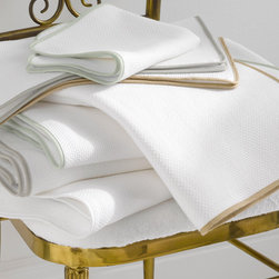 Comforting and Luxurious Bath Details - Como towels trimmed in soft colors. Clean and simple.