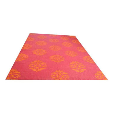 Used Jaipur Maroc Nada Canterbury Flat weave Rug 9 X 12 - A Jaipur 9 x 12 flat weave rug in pink and orange. This rug was used in a guest room for the last year with minimal traffic - maintaining great condition! The rug was purchased from Zinc Door about a year ago. There are no visible stains tears, etc. It comes from a pet-free home.