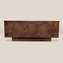 Sideboard No. 1 - Pictured in walnut. Sideboard with alternating grain inset circle pattern. Light reflection in the alternating grain direction produces a slightly lighter or darker tone from the rest of the cabinet as you walk around the piece producing a subtle yet striking contrast. Four drawers two doors and one shelf. Drawers feature push catches for an easy reveal. The clean lines of this modern piece can compliment a wide array of interiors and settings from bedrooms to dining rooms.