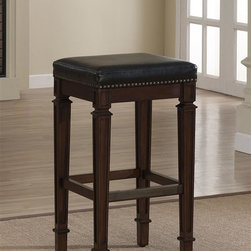 American Heritage - Monaco Bar Stool (Bar Height Stool) - Choose Stool: Bar Height StoolFinished in Navajo with a comfortable High Gloss Black Bonded Leather Cushion. This Wood Stationary stool is Consumer Assembly with Adjustable Leg Levelers. Brass foot plate. 1 Year Warranty. Clean with a damp cloth; warm water only. Counter Height Stool: 16 in. W x 16 in. D x 26 in. H (23 lbs). Bar Height Stool: 16 in. W x 16 in. D x 30 in. H (24 lbs). Assembly Instructions