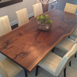 Contemporary Beach House Classic - Another view of the table showcasing the wonderfully figured grain of the stunning Black Walnut Slab Top along with the full eight dining chairs, thanks to the client.