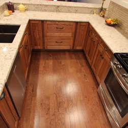 Kitchen Renovation, Green, OH #1 - In this kitchen renovation, a wall was removed to open up the floor plan.  For the base cabinets Waypoint 650F door style in Oak with Tawny Stain were installed and accented with Upper Cabinets in Maple with Butterscotch Glaze.