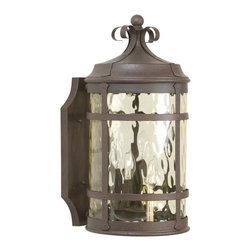 Exteriors - Exteriors Espana Traditional Outdoor Wall Sconce - Large X-19-4205Z - This large Craftmade Espana Traditional Outdoor Wall Sconce is a piece with a little bit of flair and a lot of style. You can't help but notice the design of the frame in an rustic iron finish and hammered champagne glass diffuser. It has a traditional Spanish design that will complement a wide range of architectural styles.