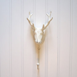 Cast Iron Deer Head Wall Hook Refinished in Shabby Creamy White by The Door Stop - I love this classic white deer hook. Wouldn't it look lovely with a pair of red Swedish mittens dangling below?