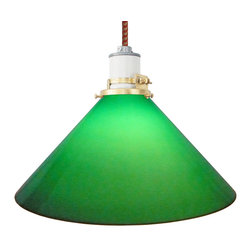 Manhattan Project Design Shop - The Carmine Lamp - Imagine yourself in an ultracool vintage pool hall or danceteria, sans the smokey interior, and transport yourself to a time of ease with this unique retro-inspired pendant lamp. The gorgeous, translucent green-glass shade is perfectly offset by the clean modern industrial white ceramic socket design, and the included stylish cotton cording in your choice of colors.