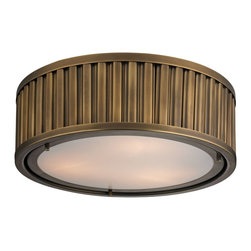 Elk Lighting - EL-46121/3 Linden 3-Light Flush Mount in Aged Brass - The Linden Collection features a drum shape made from a textural wall of metal or crystal. A frosted glass diffuser (metal tube items) or textured clear glass (crystal items) is cleverly recessed into the drum for a smooth, seamless appearance. Various finishes, including polished nickel, brushed nickel, aged brass and oil rubbed bronze are adaptable into any color scheme.