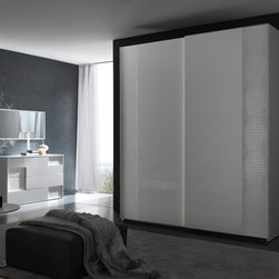 Rossetto USA - Rossetto USA Nightfly 95 in. 2 Door Sliding Wardrobe - White - T412030121068 - Shop for Closet from Hayneedle.com! Fill your bedroom with elegance and charm with the brilliantly finished and conveniently spacious Rossetto USA Nightfly 95 in. 2 Door Sliding Wardrobe - White. Contrasting textures and a pure white finish give this exquisite piece a grand presence that can't be denied. The exterior was designed by Italian craftsmen who used hardwood solids and veneer for incredible durability and then coated in a glossy lacquer finish that shimmers. But this wardrobe's most fetching quality has to be the unique albino crocodile leather upholstery around the borders and along the hanging rail. Its two sliding doors glide open effortlessly to expose a deep storage space that gives you plenty of room to hang all of your garments and it even has an overhead shelf that's perfect for hats shoes and other treasures set aside for a special occasion. Measures 27W x 95D x 93H inches. Some assembly is required.About Rossetto USA Rossetto USA is the U.S. division of the Arros Group a leading manufacturer that exports Italian furniture style and design all over the world. Operating out of its warehouse in High Point N.C. since 1999 Rossetto provides complete contemporary and modern dining bedroom and occasional furniture programs that combine affordable price with innovative Italian design to satisfy the demands of their distinguished customers.