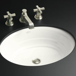 "Kohler - Kohler K-2832-0 white Garamond Garamond 19-5/8"" Cast Iron Undermount - Product Features:Oval basin couples functionality with aesthetic appealCovered under Kohler s limited lifetime sink warrantyConstructed of enameled cast-iron which combines strength, durability and insulation benefitsOrganic, welcoming touch delivered by subtle concentric ringsExudes distinguished style in your bathroomUndermount installation delivers the classic look and feel to any bathroomCenter drain location provides optimal draining capabilityAll hardware needed for installation includedProduct Technologies / Benefits:Undermount Sinks: Create a seamless counter-to-basin transition. Sleek styles and ease of cleaning are what makes these the preferred design choice.Enameled Cast-Iron: Kohler Enameled Cast-Iron combines the strength, durability, and insulation benefits of cast-iron with the scratch, chip, and burn resistance of a baked, powder coat finish and comes with an exceptional Lifetime Limited Warranty. These materials combined give the sink or tub the strength to last a lifetime of use. Another benefit is that Kohler Enameled Cast-Iron is available in a wide variety of specialty colors to truly customize your home.Product Specifications:Height: 7-9/16"" (measured from the bottom of sink to the top of the rim)Overall Width: 16-1/4"" (measured from the back outer rim to the front outer rim)Overall Length: 21-1/16"""" (measured from the left outer rim to the right outer rim)Basin Width: 15"" (measured from the back inner rim to the front inner rim)Basin Length: 19-5/8"" (measured from the left inner rim to the right inner rim)Basin Depth: 5-1/2"" (measured from the center of basin to the rim)Installation Type: Under"