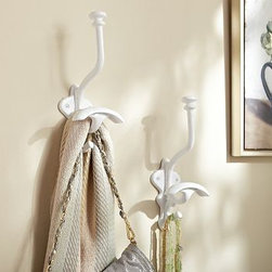 "Ceramic Hook, White - These sturdy hooks do double duty. Place individual hooks in rooms throughout the home so there's always a spot to hang coats, bags and even decorative items such as wreaths. 3.75"" wide x 4.75"" deep x 11"" high Made of aluminum with a painted, matte white finish. Mounting hardware included. Catalog / Internet only. Sold individually."