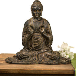Verdi Buddha - Instill a sense of serenity to your master suite, bath, sitting area, or sunroom with the traditional Verdi Buddha. Fashioned from finely detailed resin, the sculpture presents a Buddha in flowing robes accentuated with a rich umber color and gentle distressing suggestive of the passage of time.