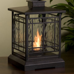 Personal Fireplace - I'm becoming a fan of these little tabletop fireplaces. I think it's a great idea for providing warmth and light in outdoor spaces.