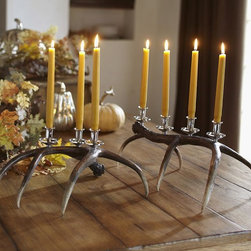 Faux Antler Candelabra - I think a pair of these antler candelabras is an elegant way to bring the outdoors in. I like the lightness and airiness that these portray with the tapered shape of the antlers.